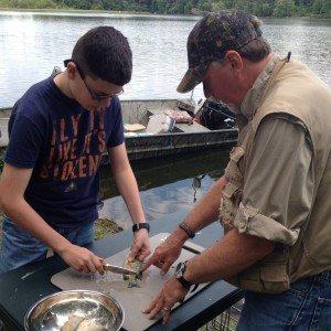 AVR 4 Orgs - MCP2 Photo - Teaching How to Clean Fish