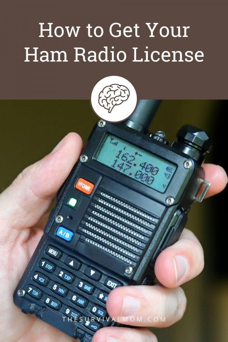 hand holding a baofeng radio, small handheld ham radio