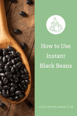 image: black beans, black beans in a wooden spoon